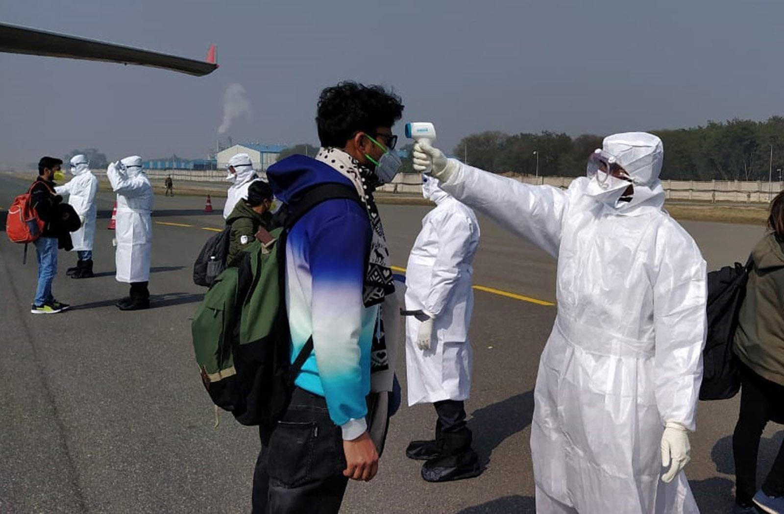 Indian passengers being screened for coronavirus at New Delhi airport