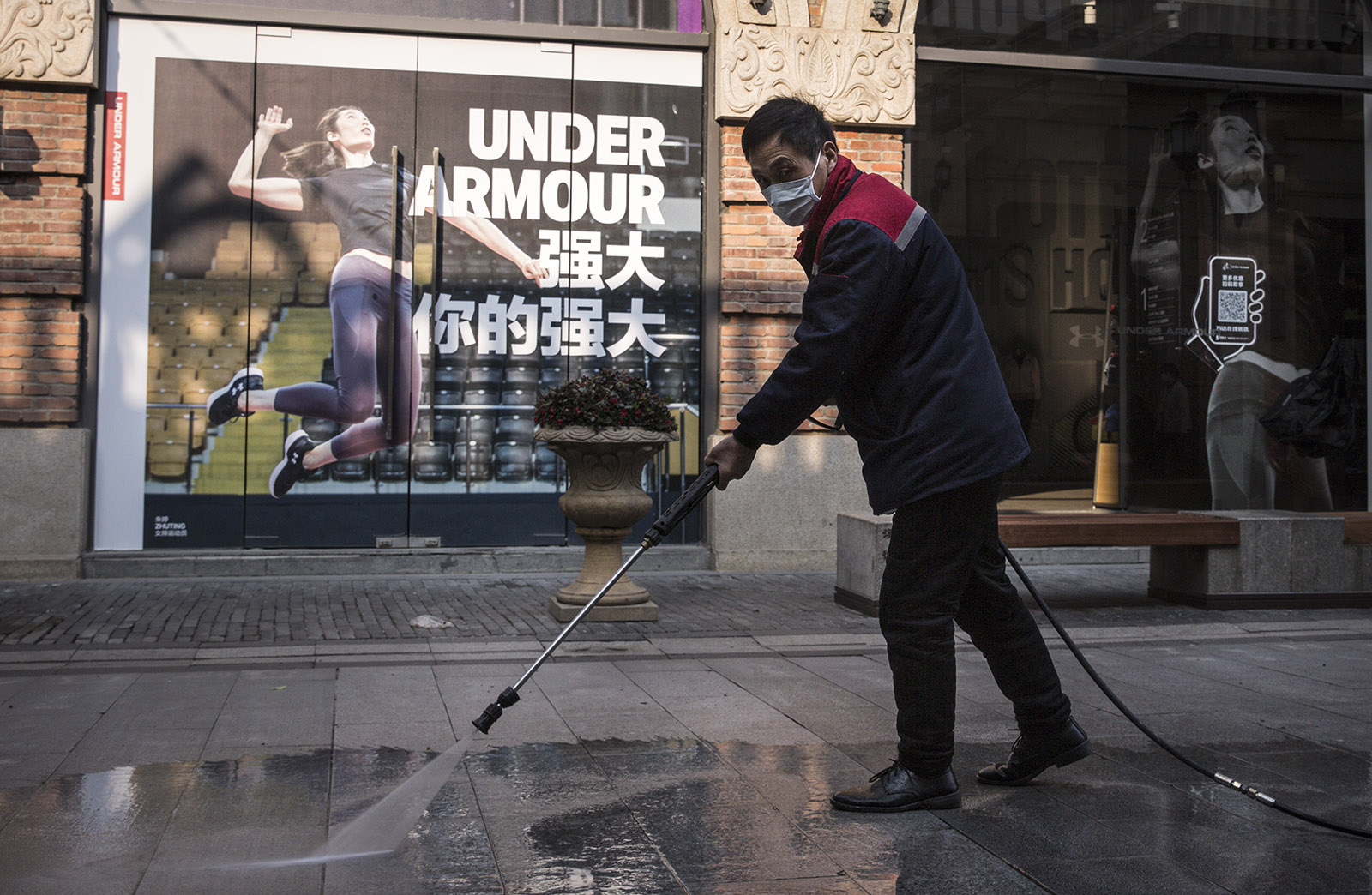 Street-cleaner washing pavement in Wuhan, China