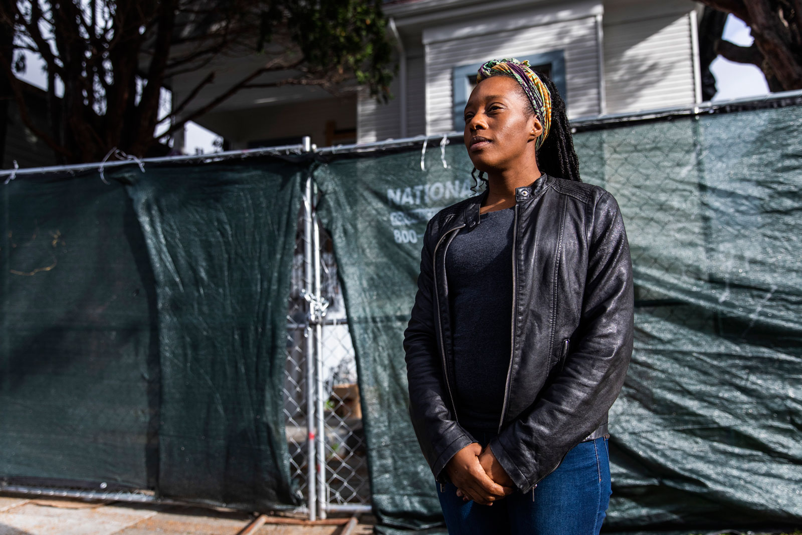 """Moms 4 Housing activist Dominique Walker standing in front of 2928 Magnolia Street, the house the group occupied starting in November 2019, declaring that housing is """"a human right,"""