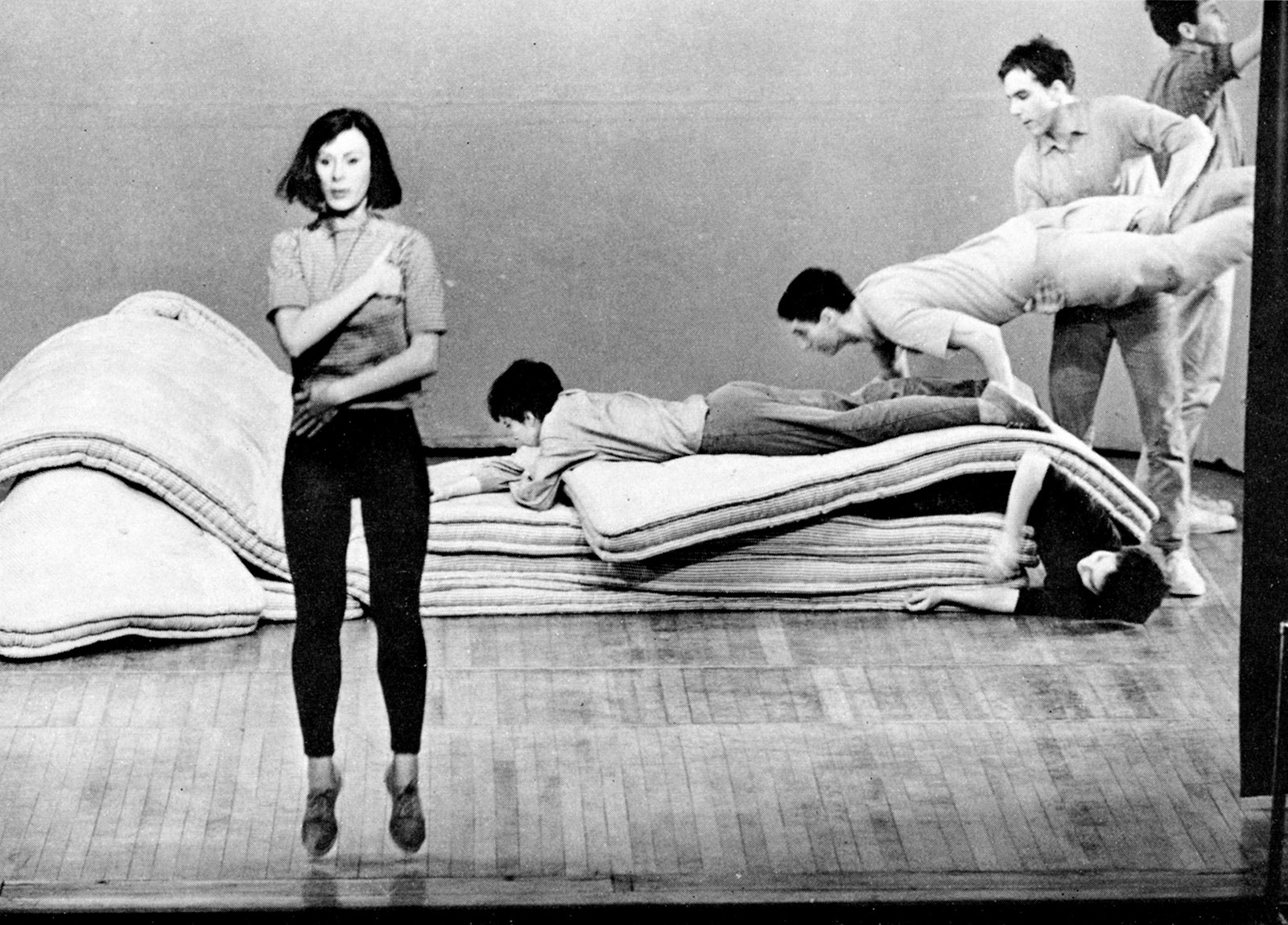 Yvonne Rainer (left) performing 'Corridor Solo' and 'Crawling Through' from Parts of Some Sextets at the Wadsworth Athenaeum, Hartford, Connecticut, 1965