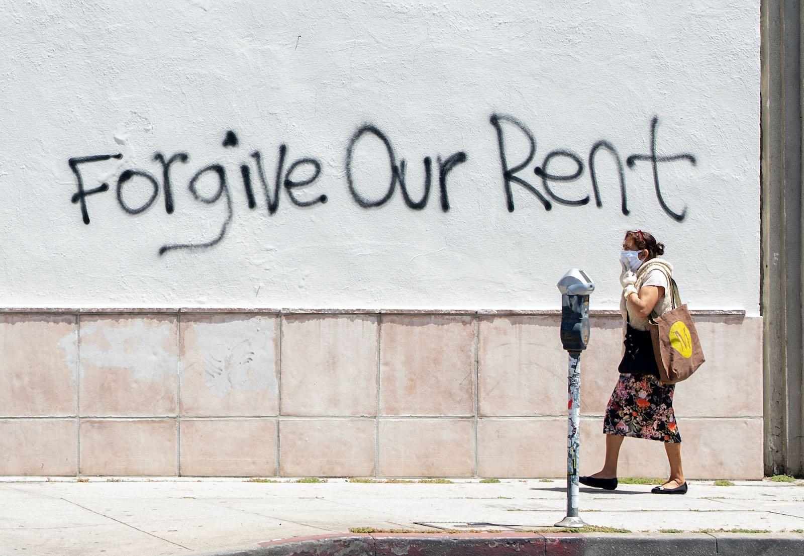 Rent forgiveness graffiti on La Brea Avenue, Los Angeles