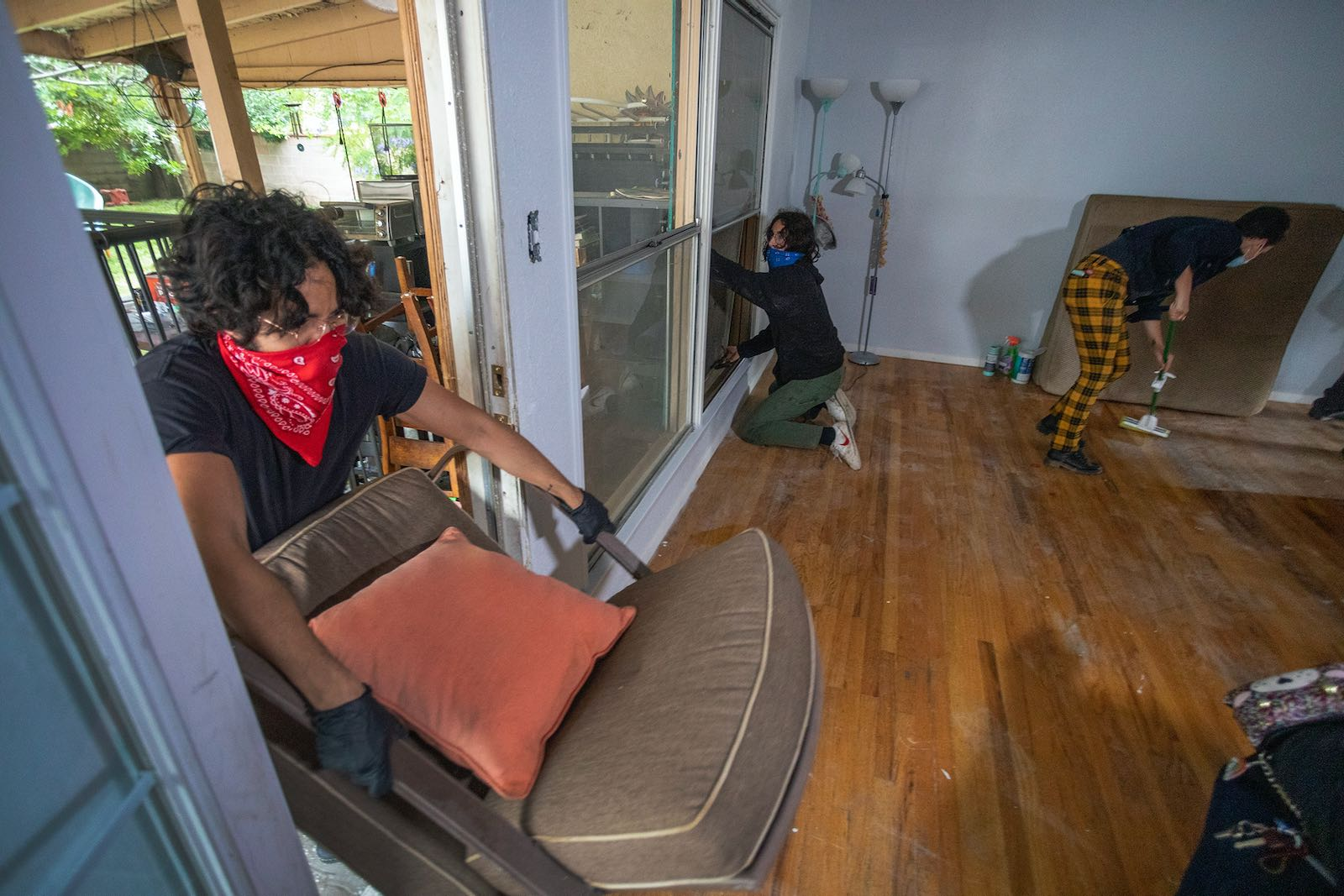 Housing activists breaking in to a boarded up home