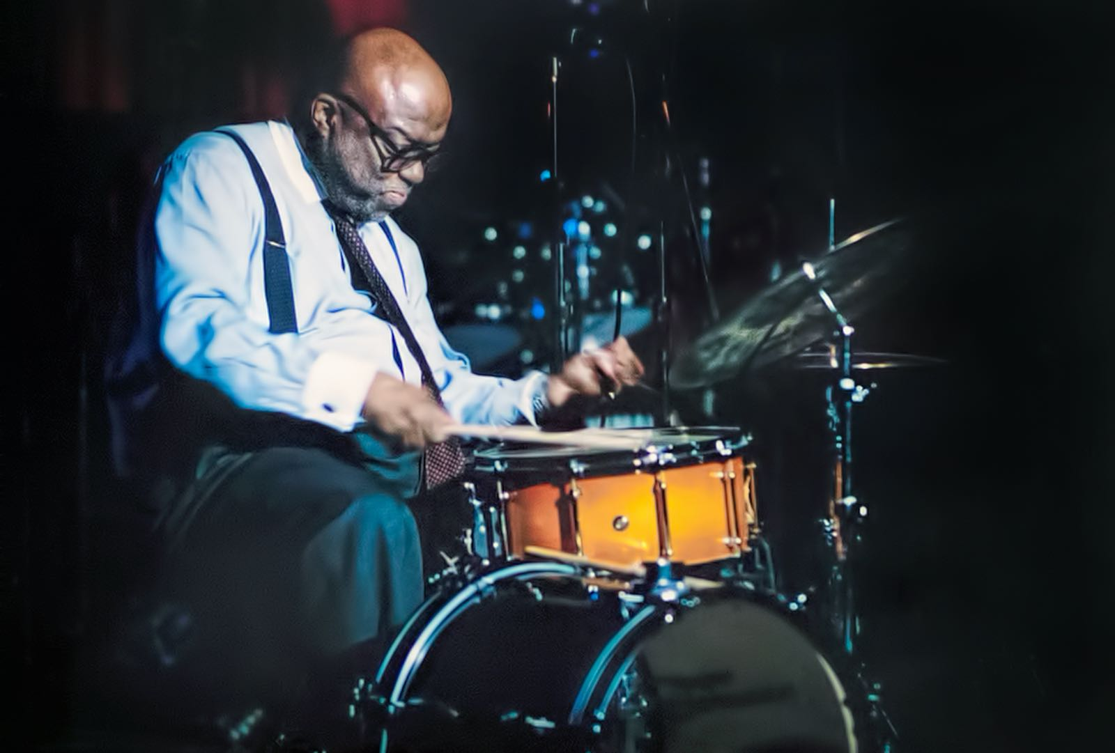 Stanley Crouch playing drums at the Jazz Journalists Association awards at B.B. King's, New York City,  2004