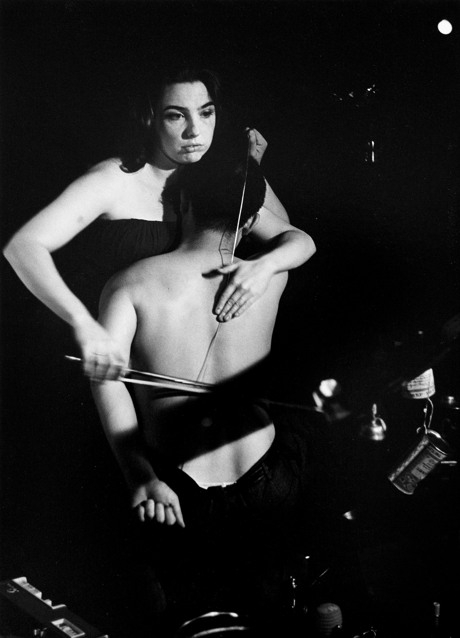 Charlotte Moorman and Nam June Paik performing John Cage's 26'1.1499'' for a String Player, 1965; photograph by Peter Moore