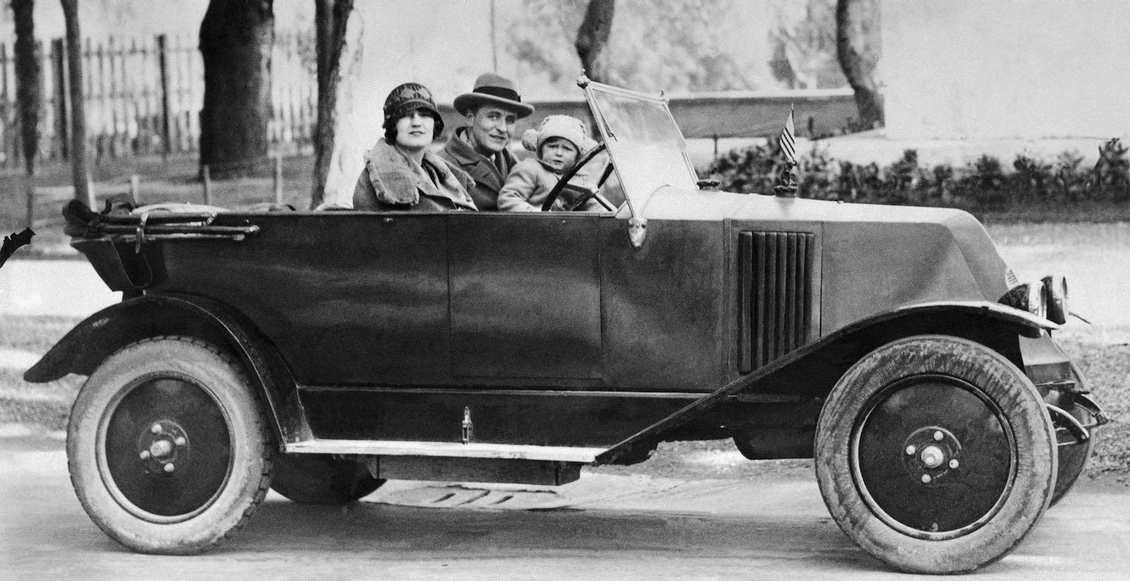 F. Scott Fitzgerald, Zelda, and daughter Scottie in an automobile