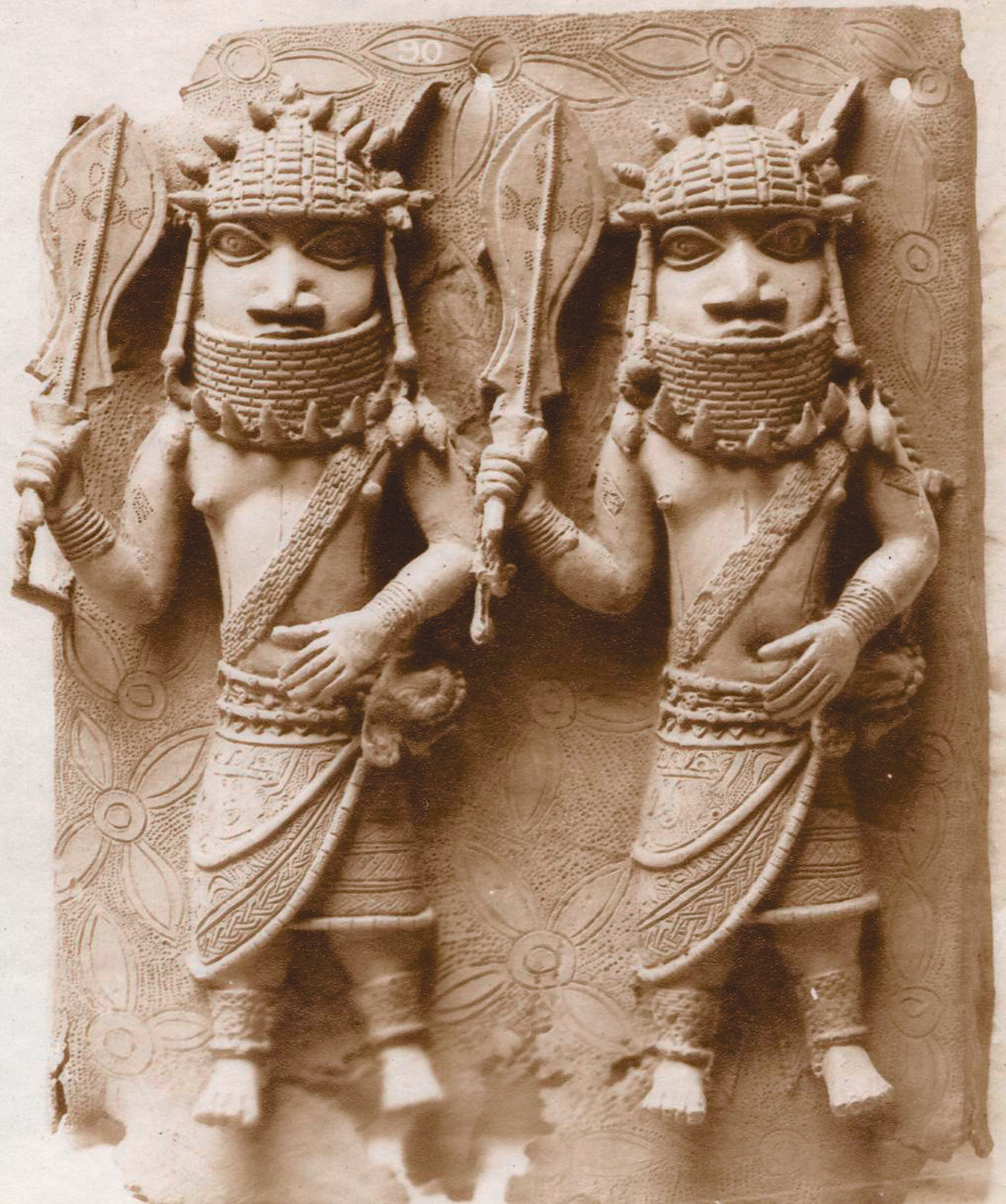 Benin Bronze plaque showing two officials with raised swords