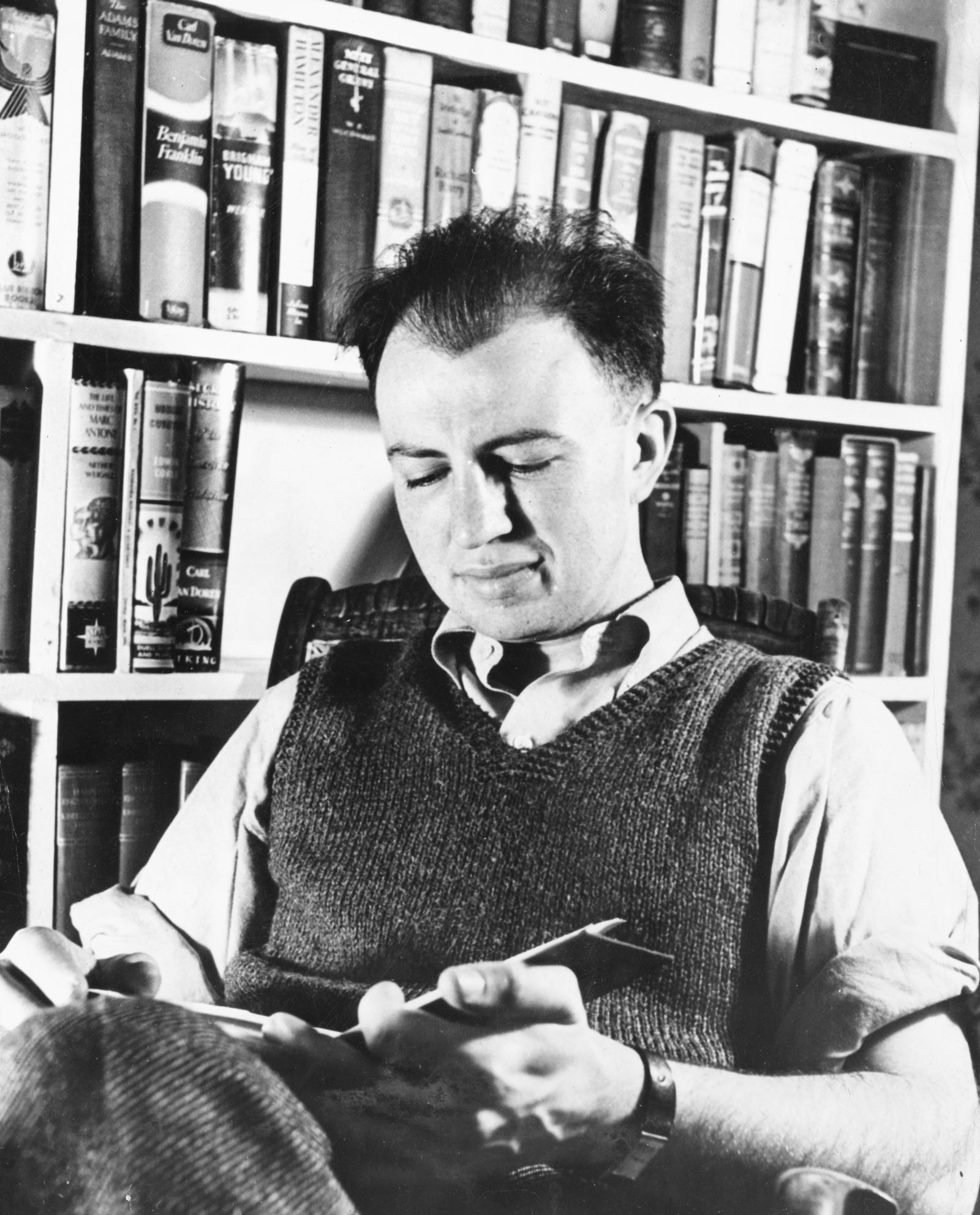 Howard Fast in his library, 1943