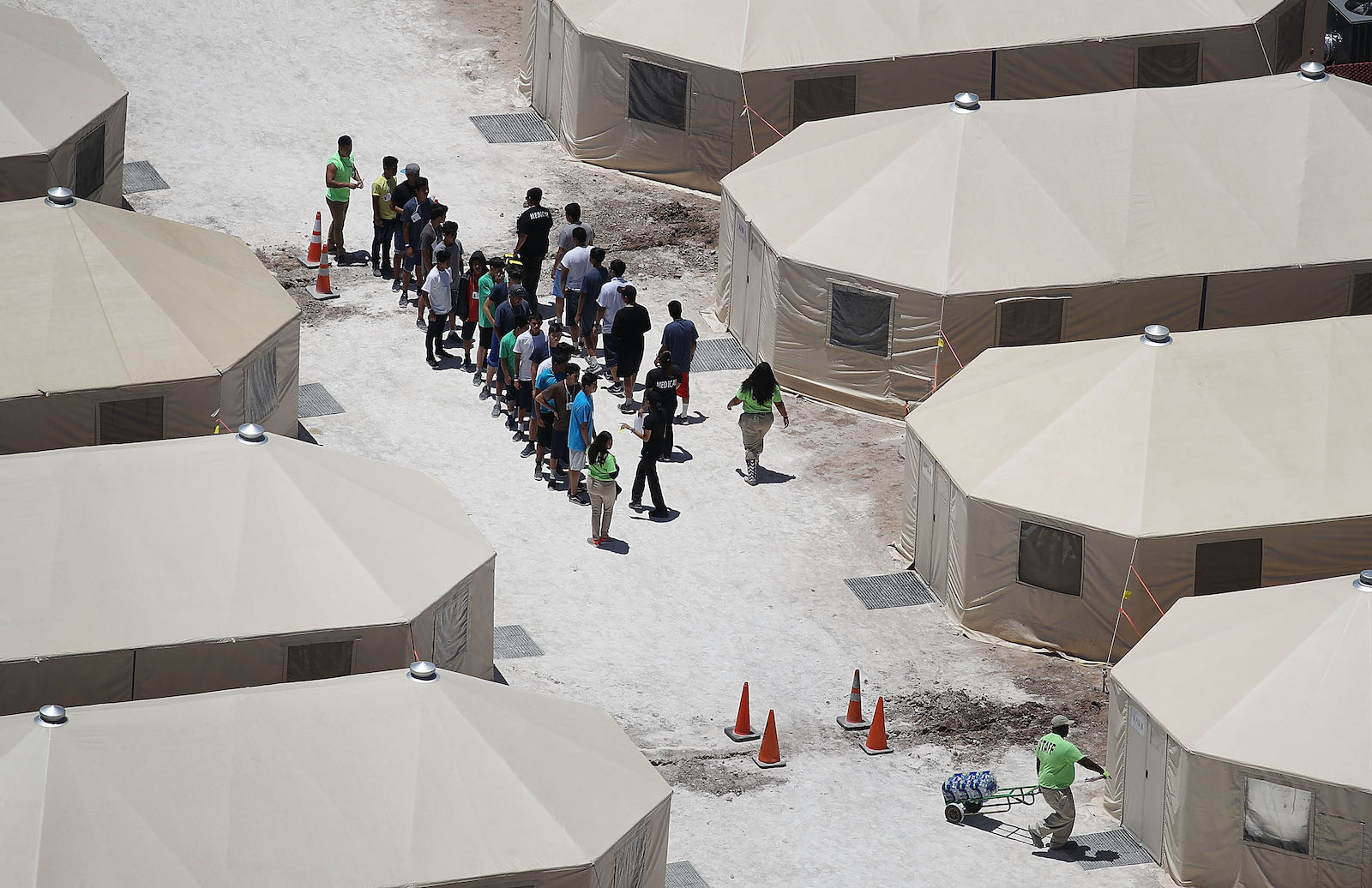 Migrant children lining up at a tent encampment detention facility, Texas, 2018