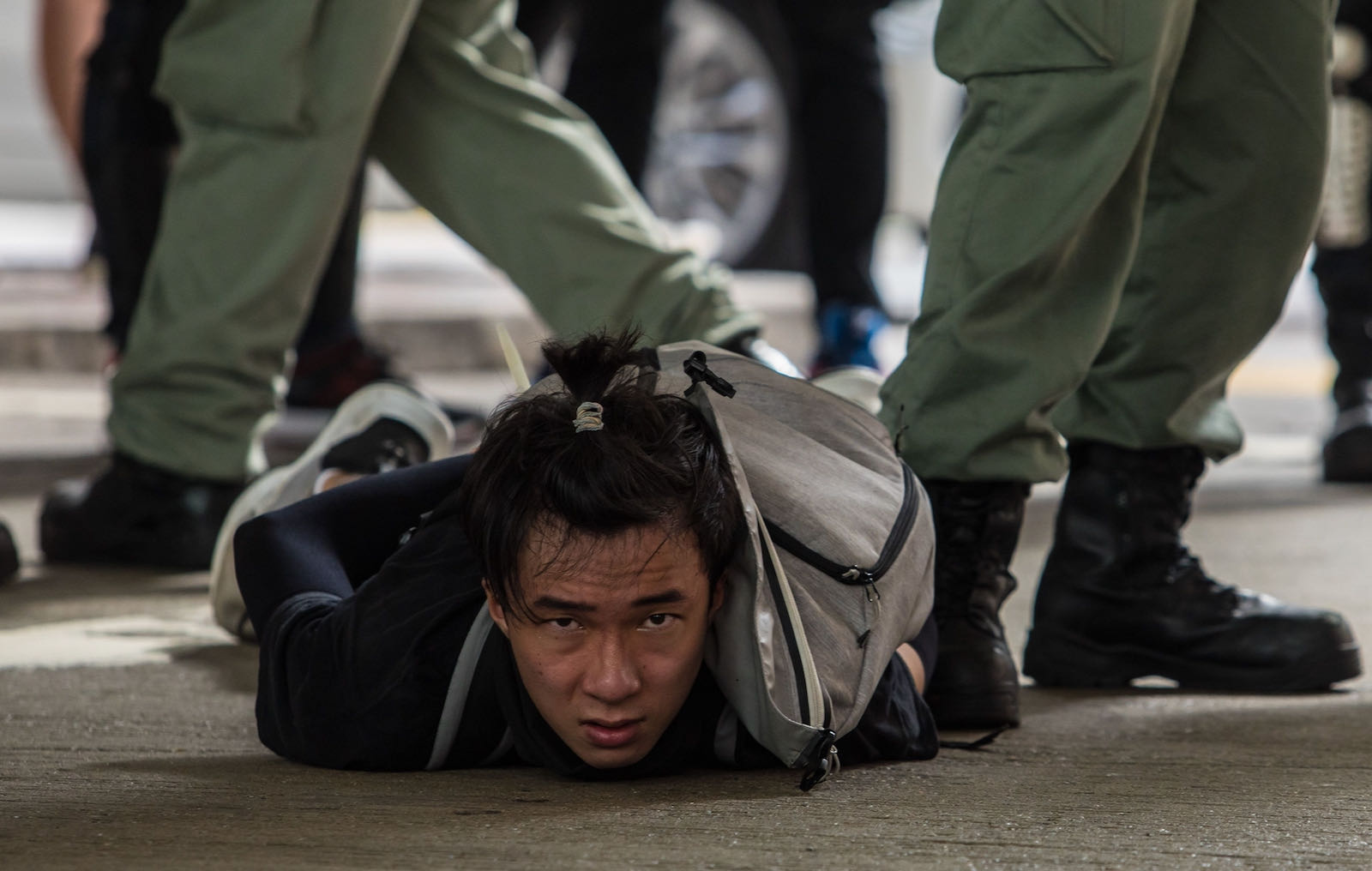 A protester detained by riot police