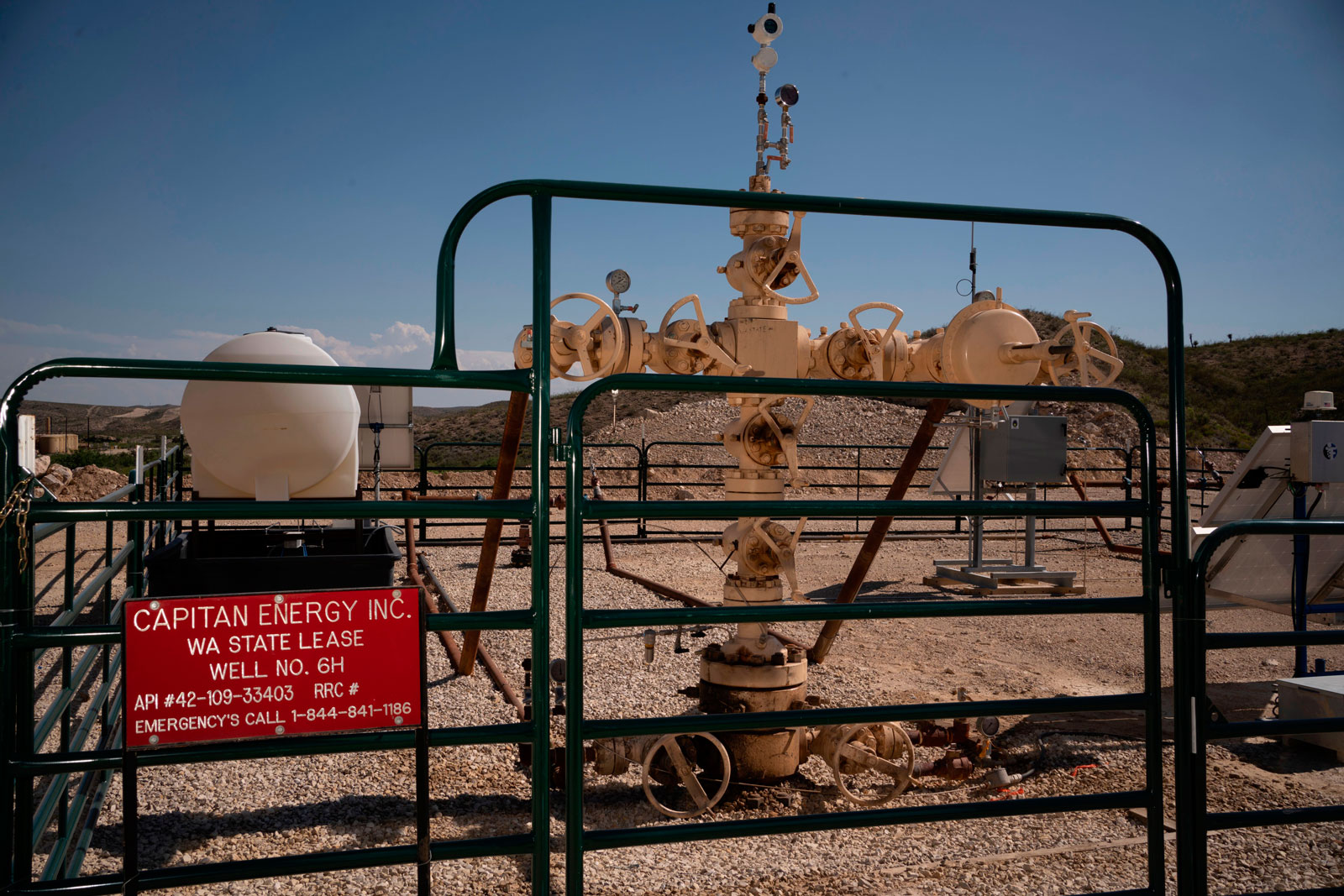 Fracking machinery surrounded by a gate and a sign that says Capitan Energy
