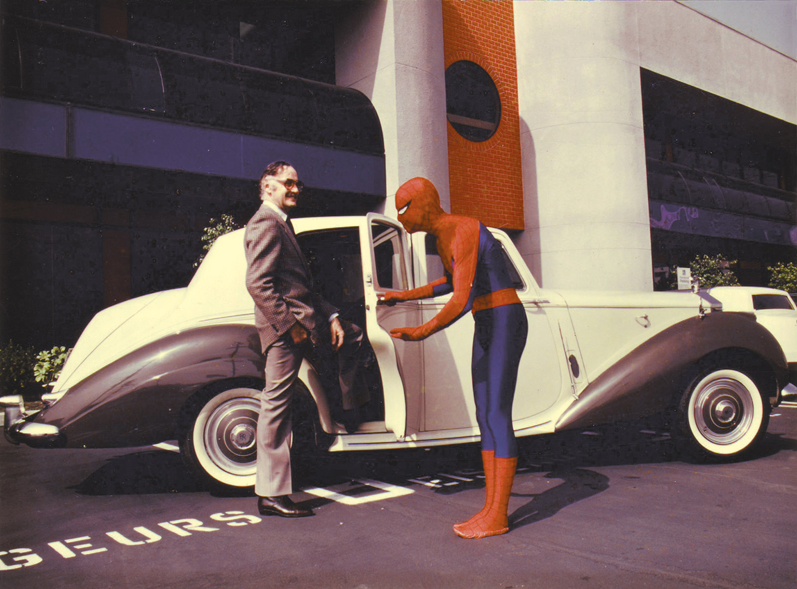 Stan Lee and a Marvel employee in Spider-man costume in the Marvel Productions parking lot