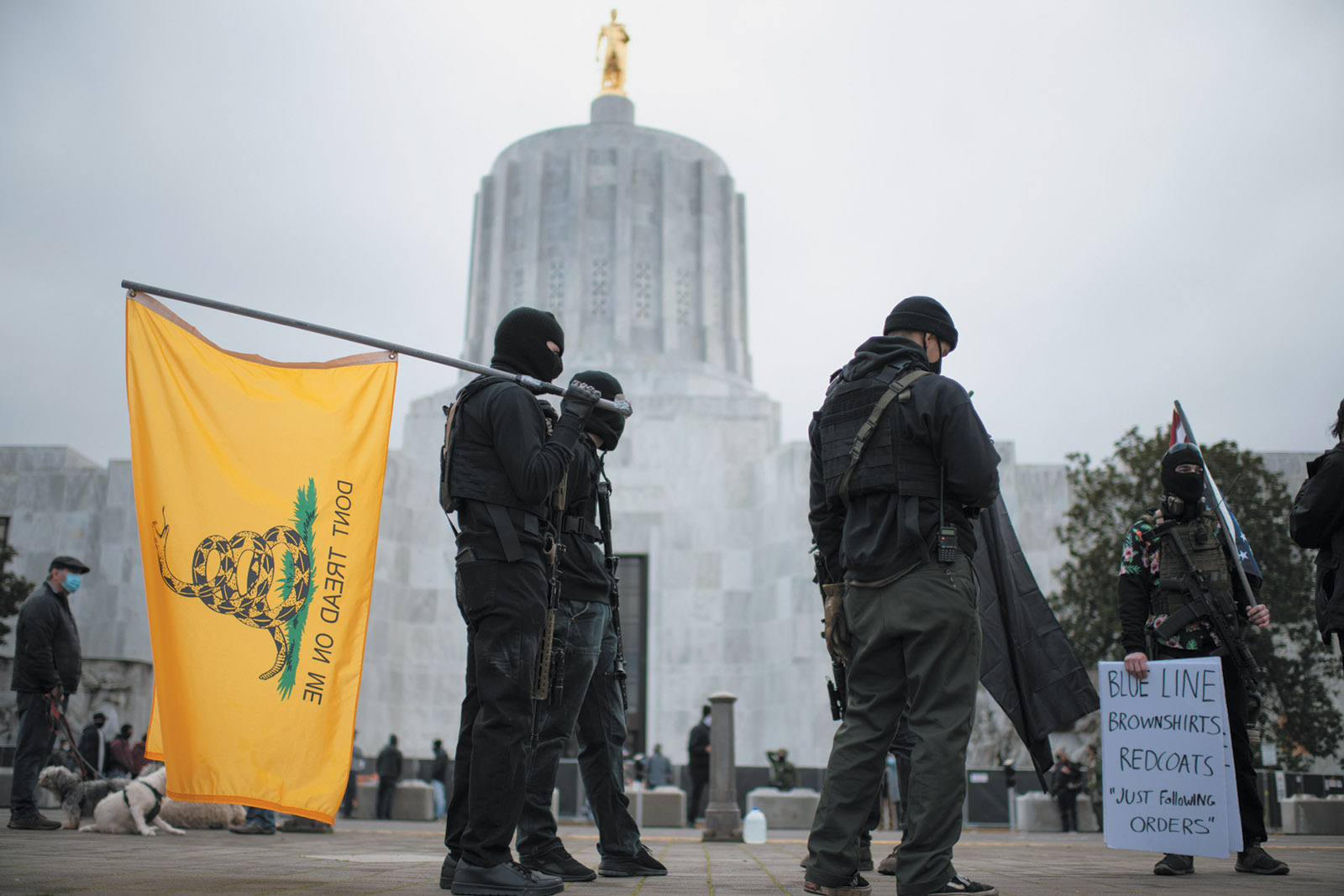 Armed members of the Boogaloo Bois in front of the Oregon State Capitol during a nationwide protest called by far-right groups in support of President Trump and his claim of electoral fraud